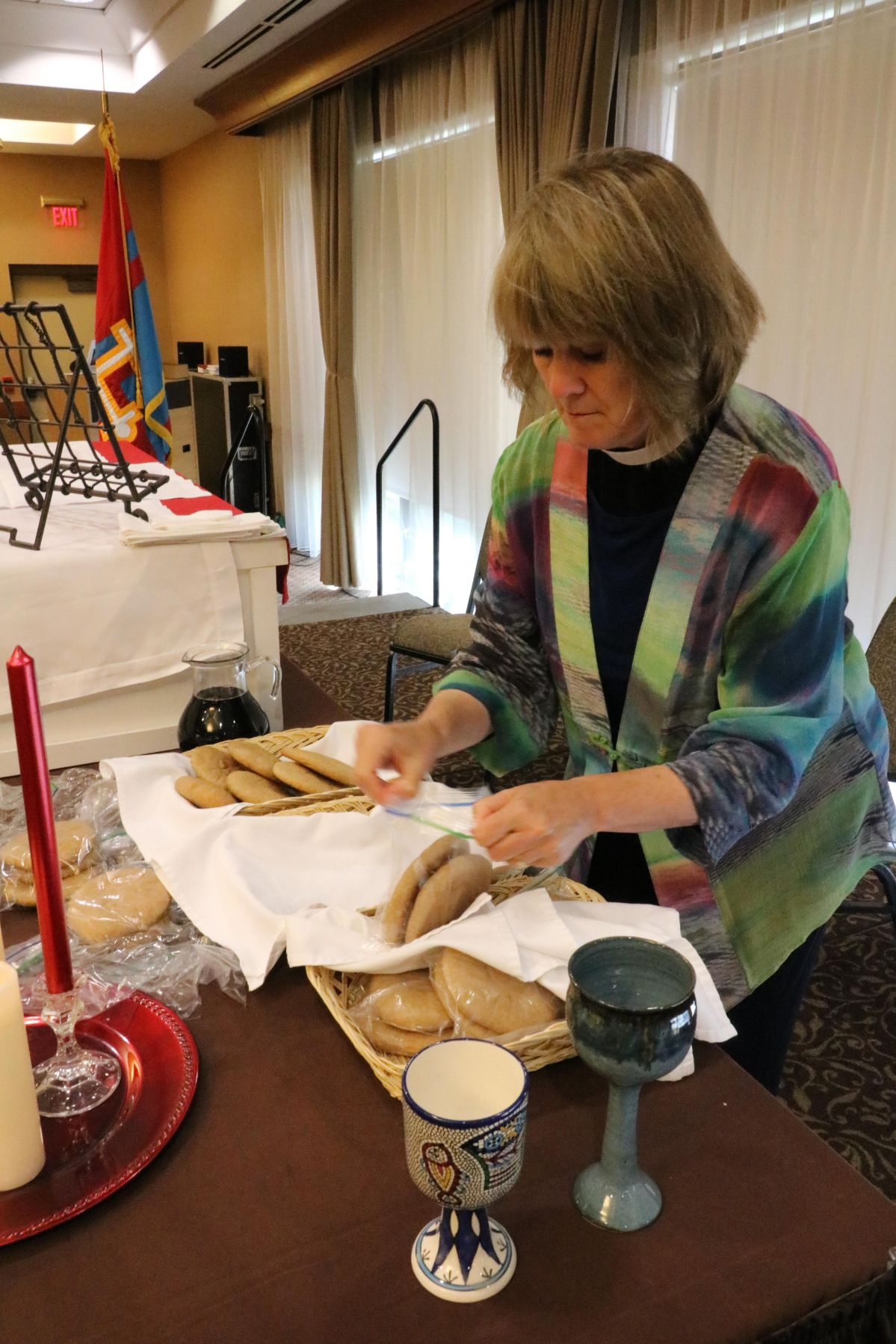 Deacon Dorothy prepares the bread and wine to be consecrated during the celebration of Holy Eucharist. Photo by Sue Cenci.