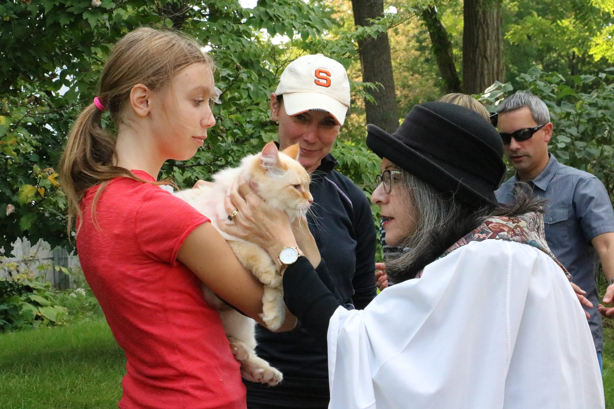 Mother Renee blesses a kitty at Trinity Episcopal Church in Fayetteville.